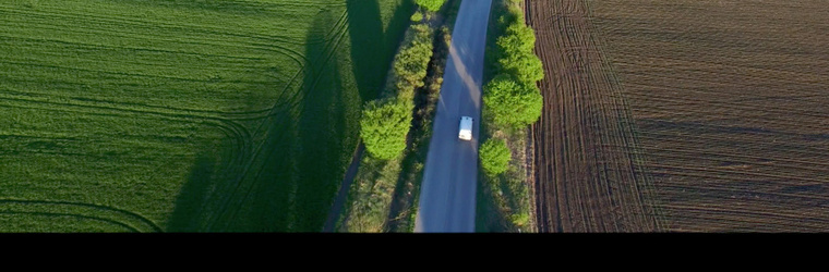 background small truck on a road aerial view tyre