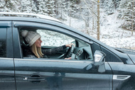 guide woman drive in snow